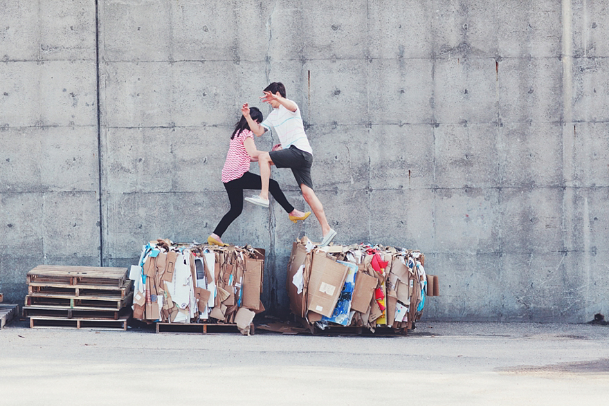 couple dancing on recycling for engagement