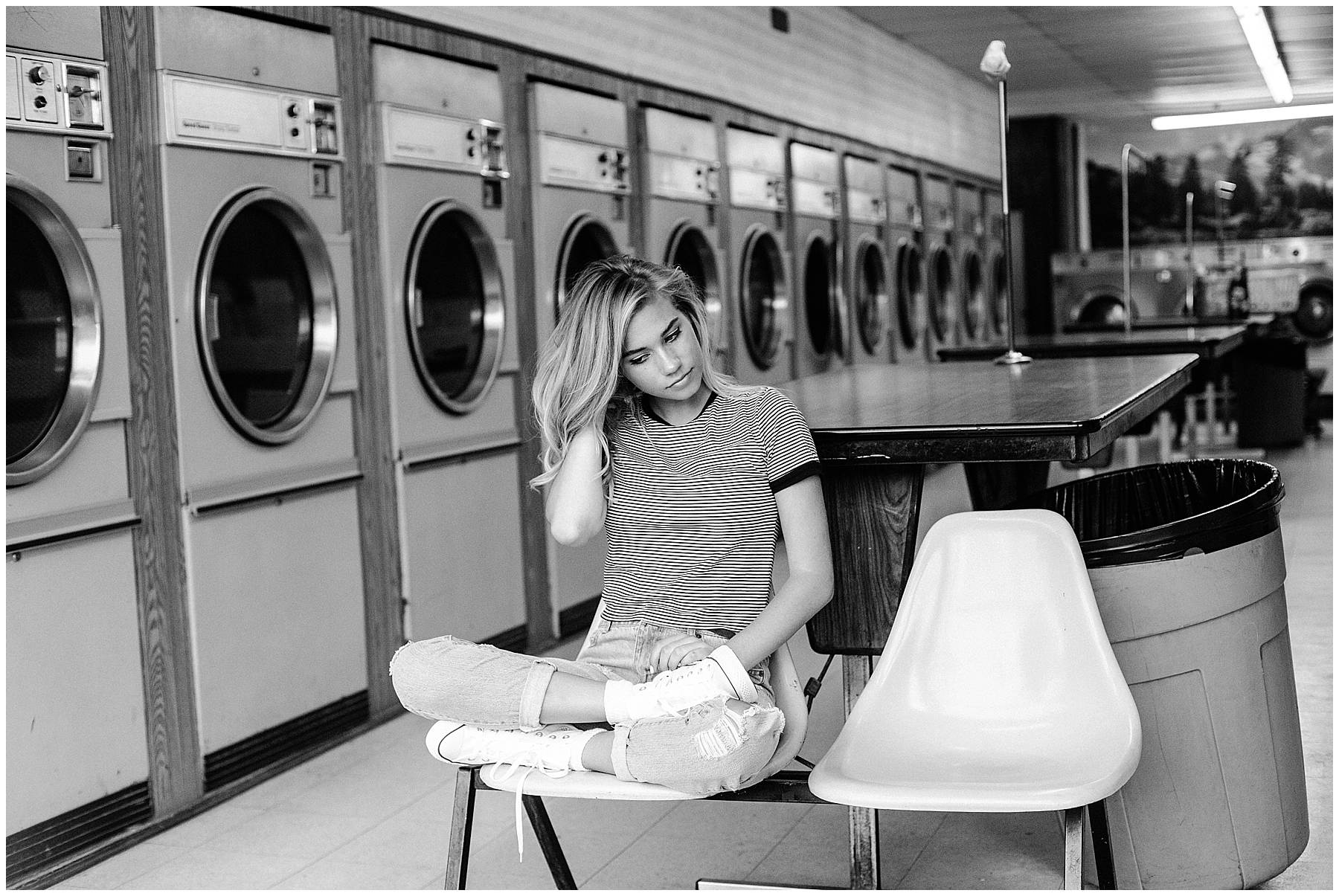Editorial style senior portrait shoot in des moines laundromat