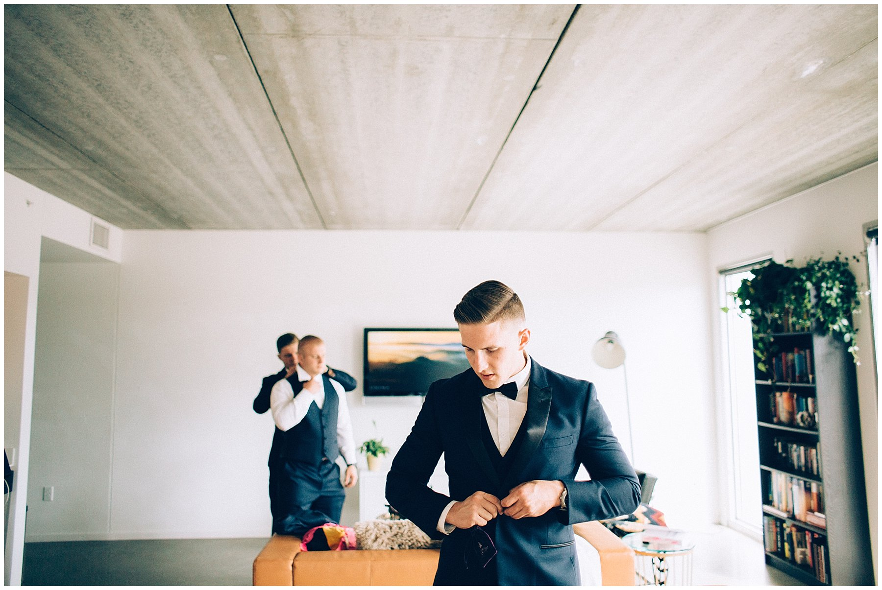 groom getting ready in modern apartment