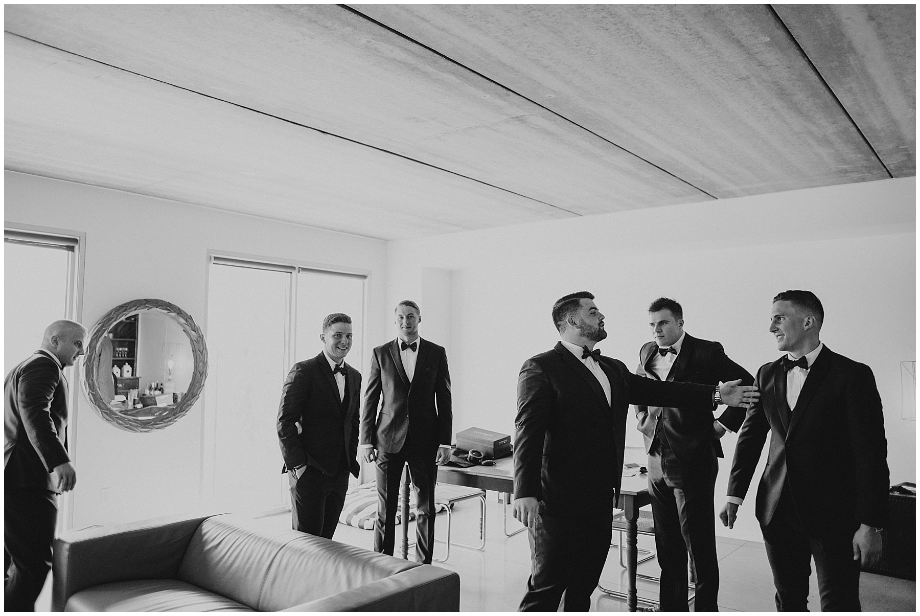groomsmen getting ready in modern apartment