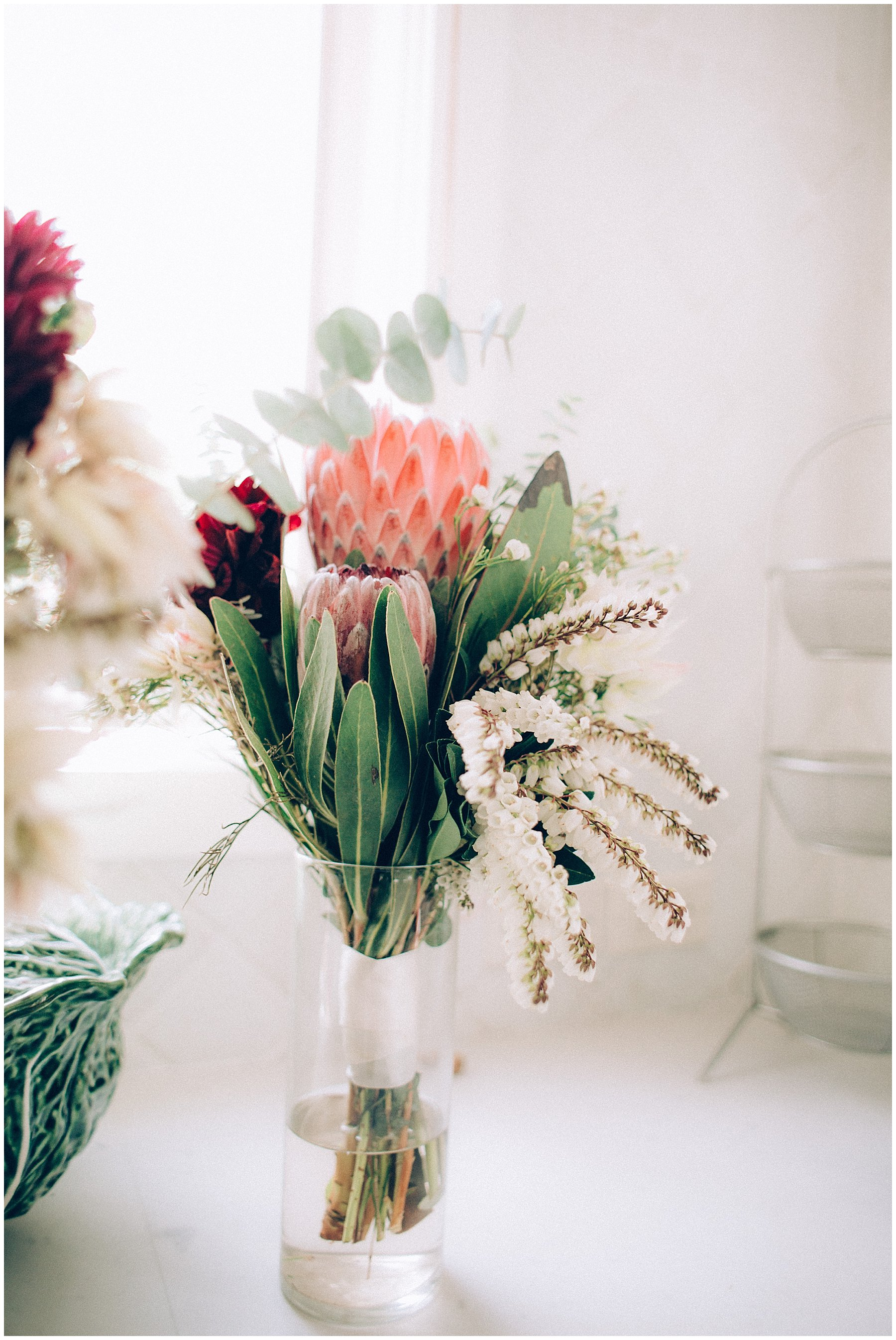 brightly colored protea bridesmaids bouquets