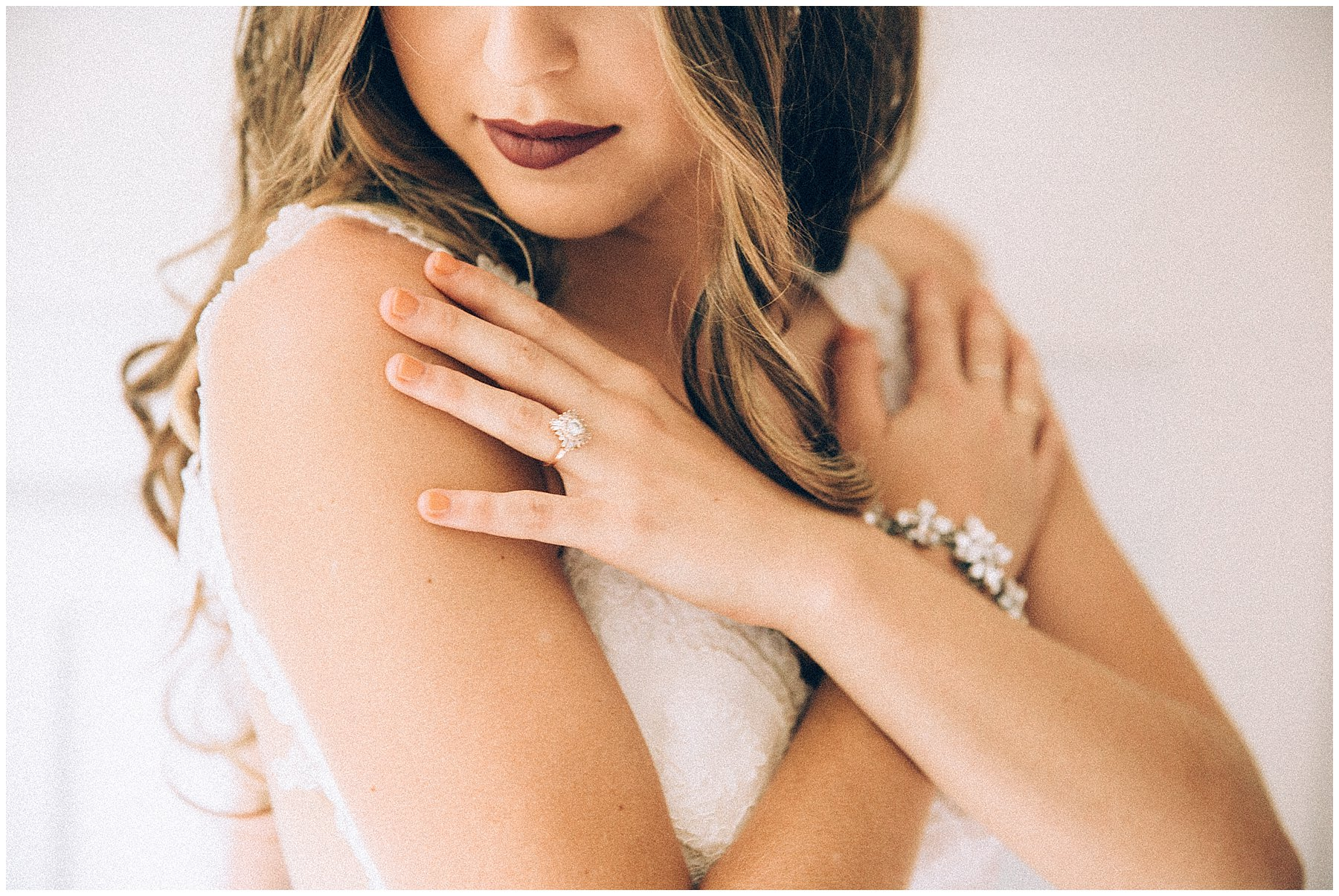 bridal with plum lipstick and minimal jewelry