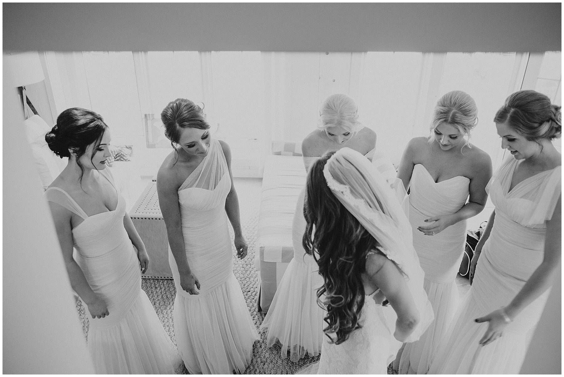 bridesmaids with bride in dramatic black and white