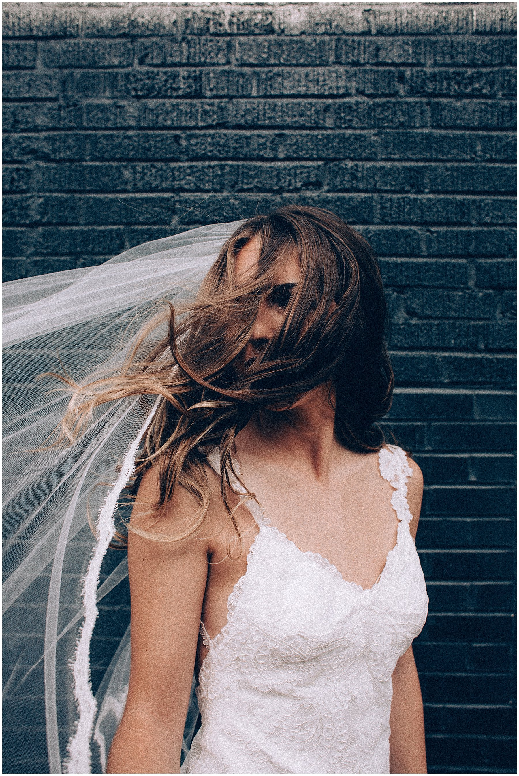bride with hair in wind during first look