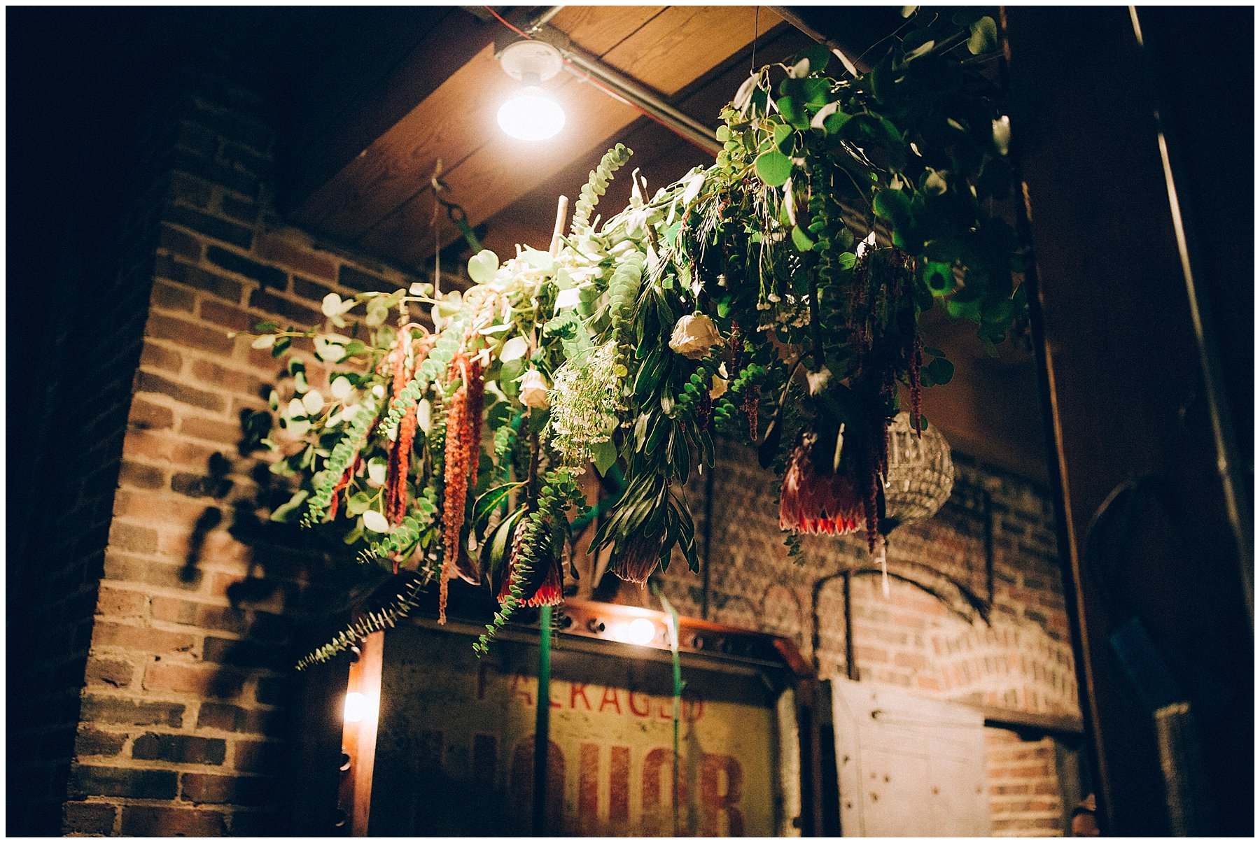protea garland at west end architectural salvage wedding Des Moines