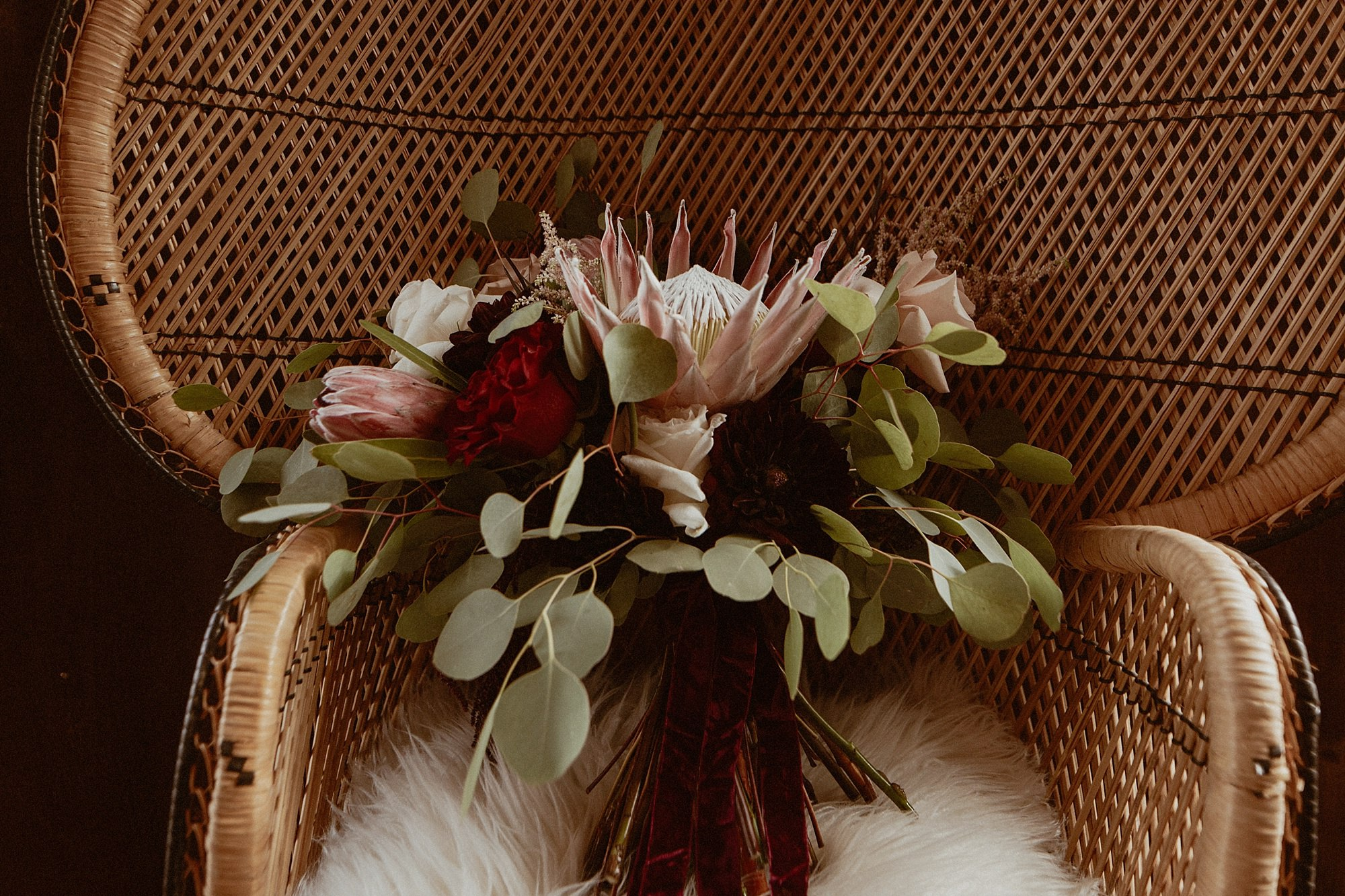Indie Floral protea bouquet at rapid creek cidery wedding