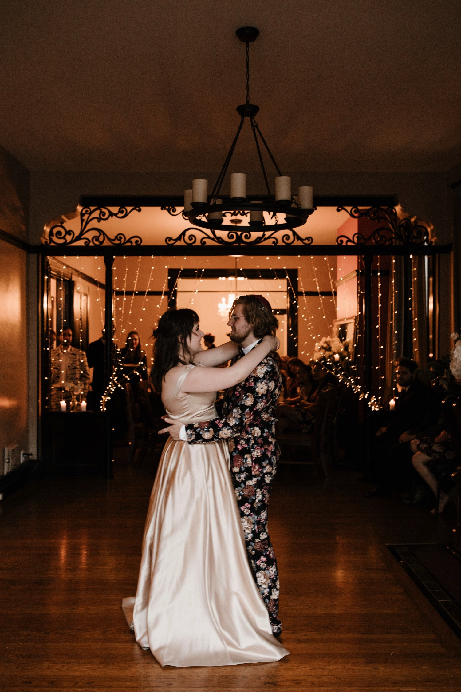 intimate and fresh modern jewish wedding at home in san francisco with groom in floral tux