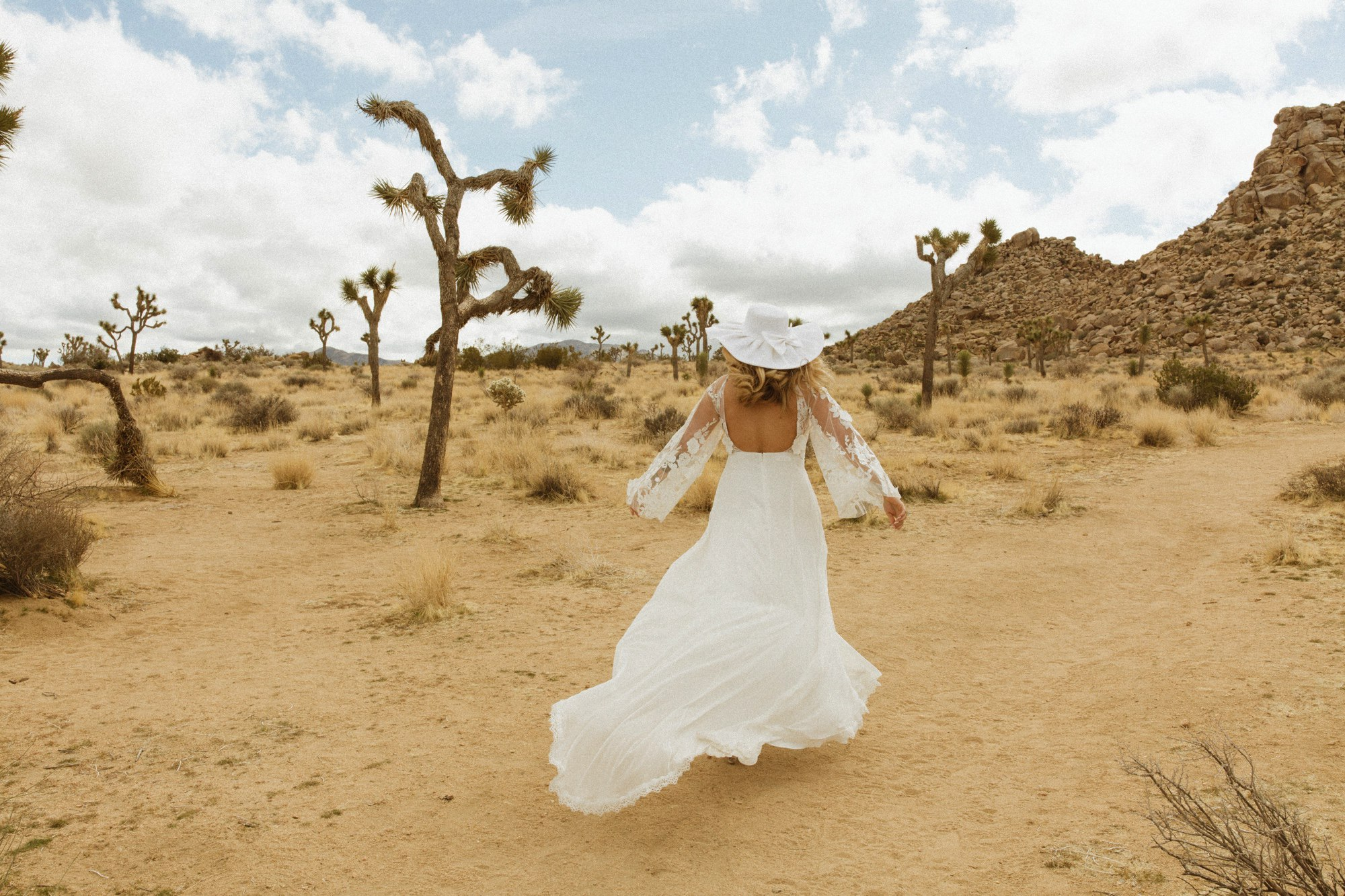 bride in hat Joshua tree wedding