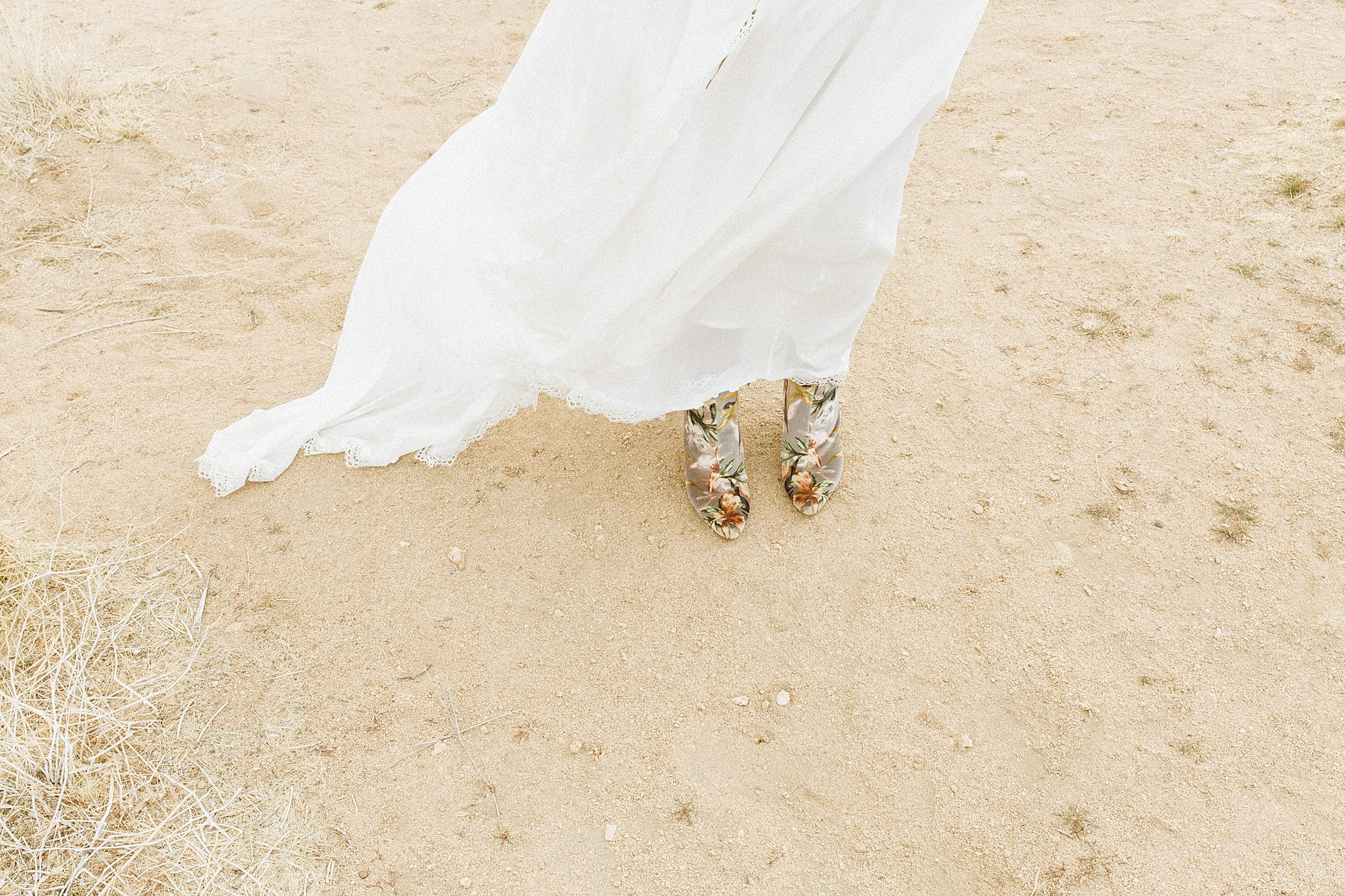 bride in floral wedding shoes Joshua tree wedding jess Lemmo
