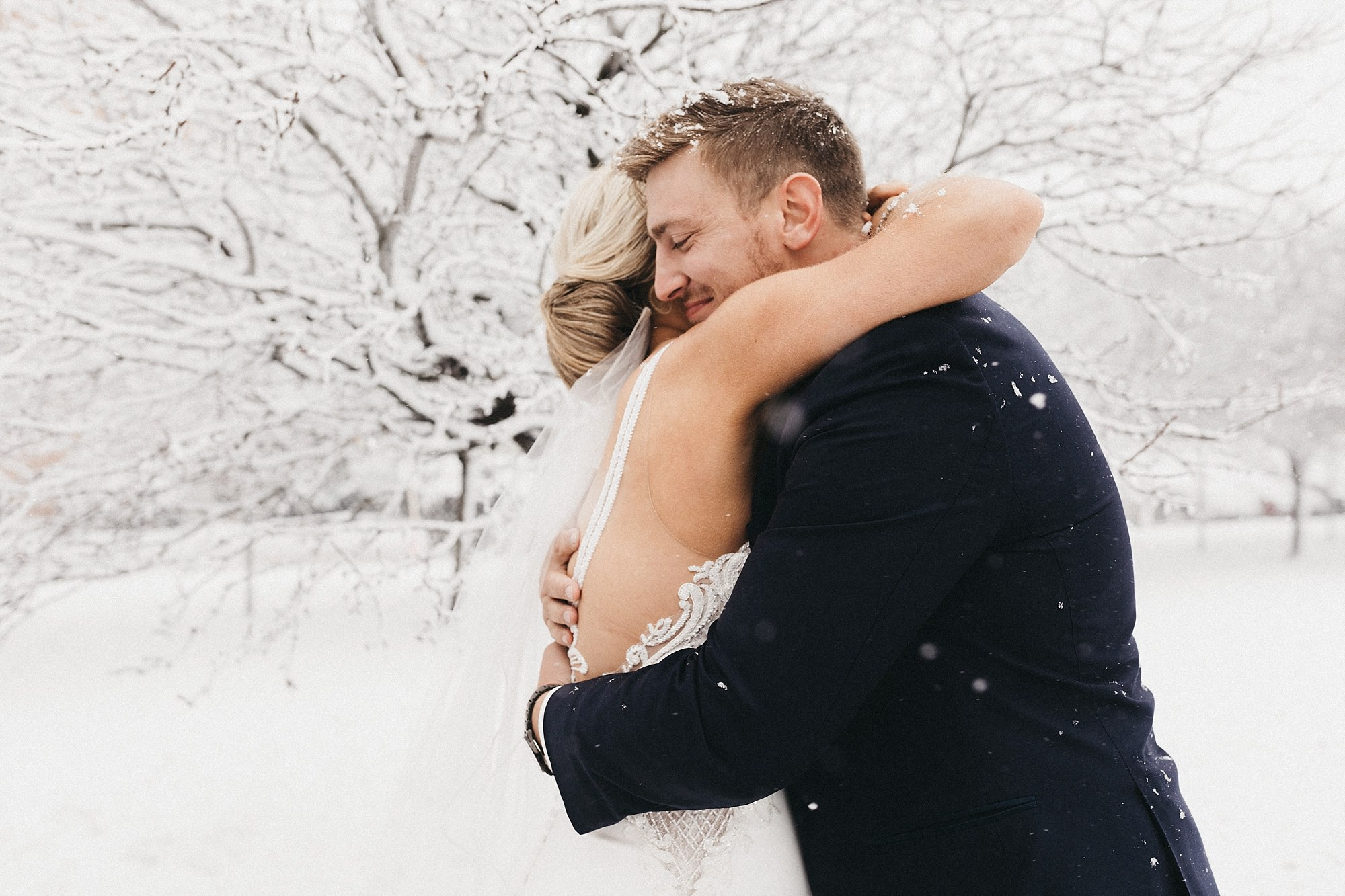 Bride and Groom on Snowy Wedding day at the Maytag Event Complex in Newton Iowa