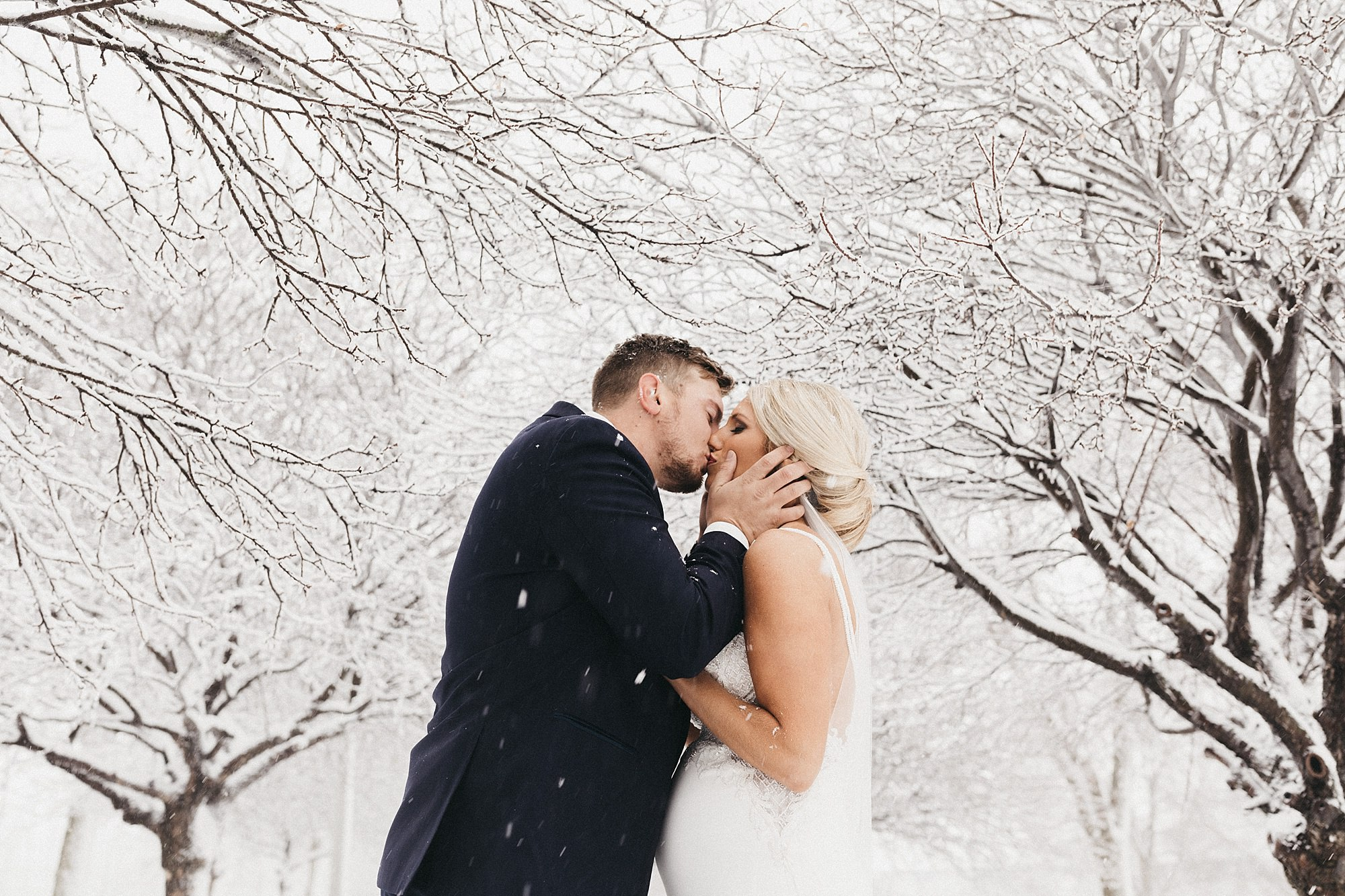 pregnant bride in the snow for first look