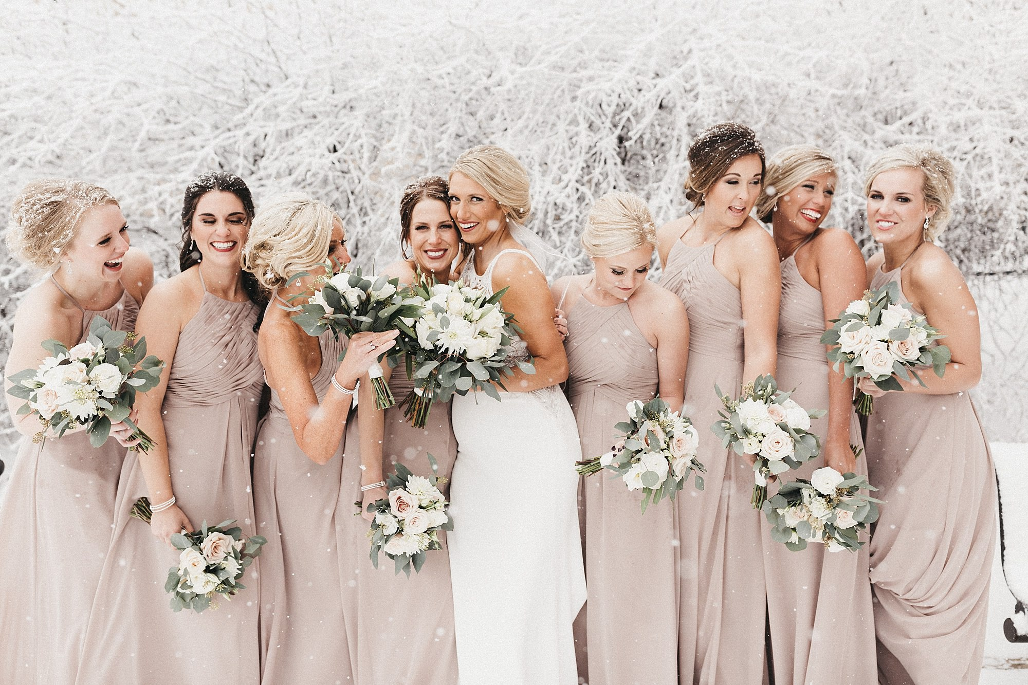 snowy bridal party portraits with pregnant bride