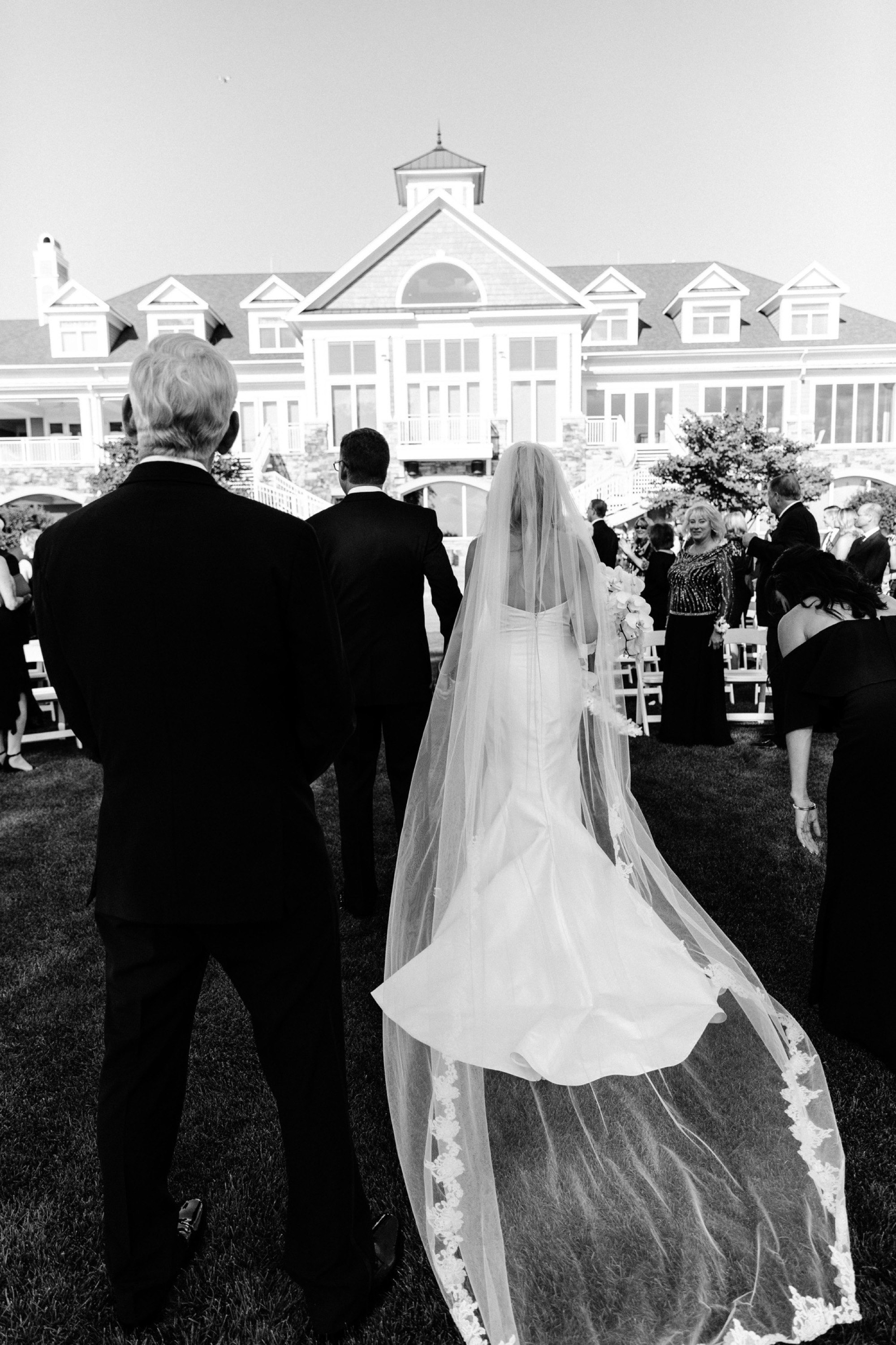 walking down the aisle as husband and wife at glen oaks wedding des moines