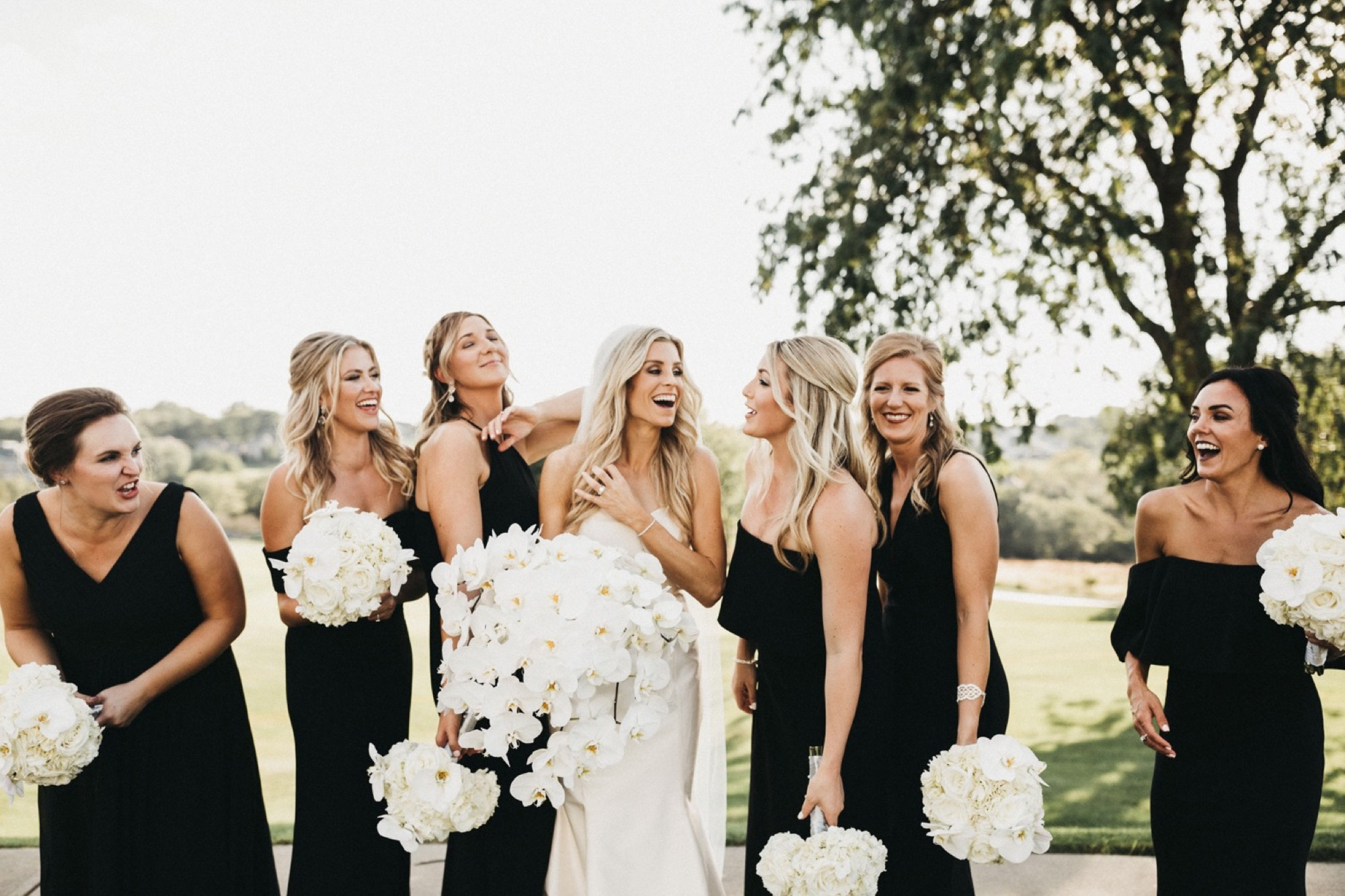 candid bridal party with modern orchid floral by saley nong at glen oaks in des moines