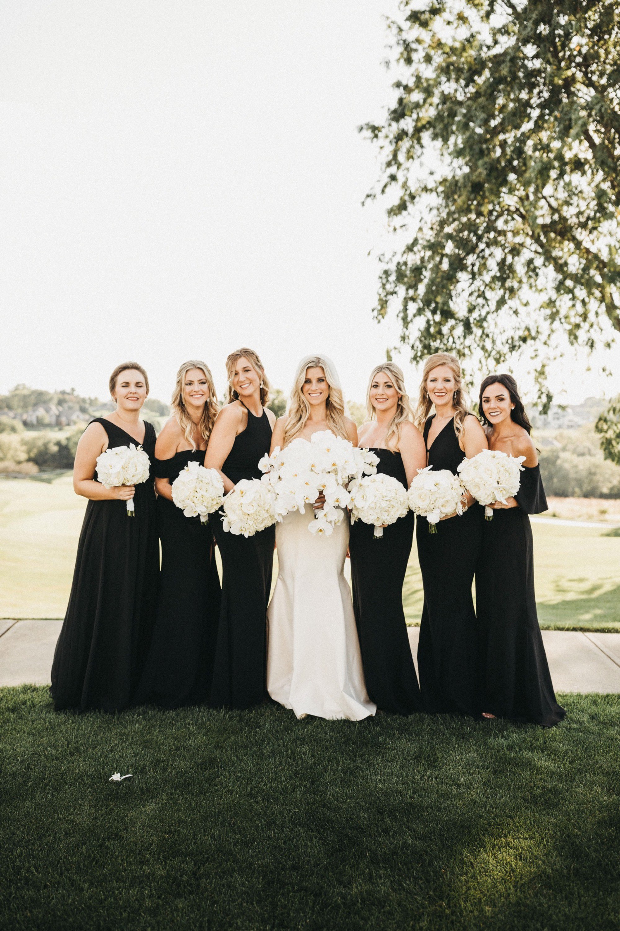 the bridal party with modern orchid floral by saley nong at glen oaks in des moines
