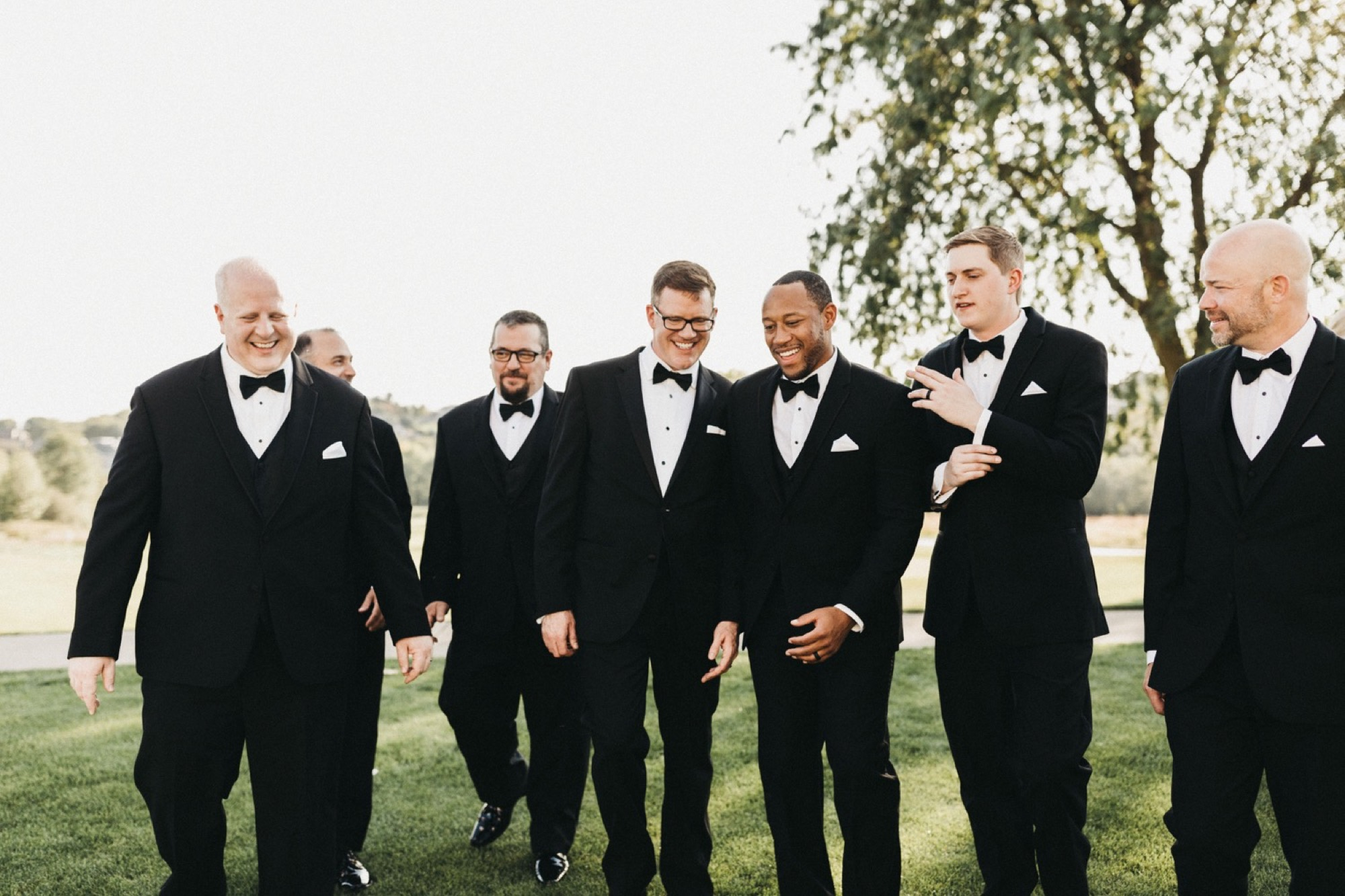 the groomsman in modern and timeless suits at glen oaks in des moines