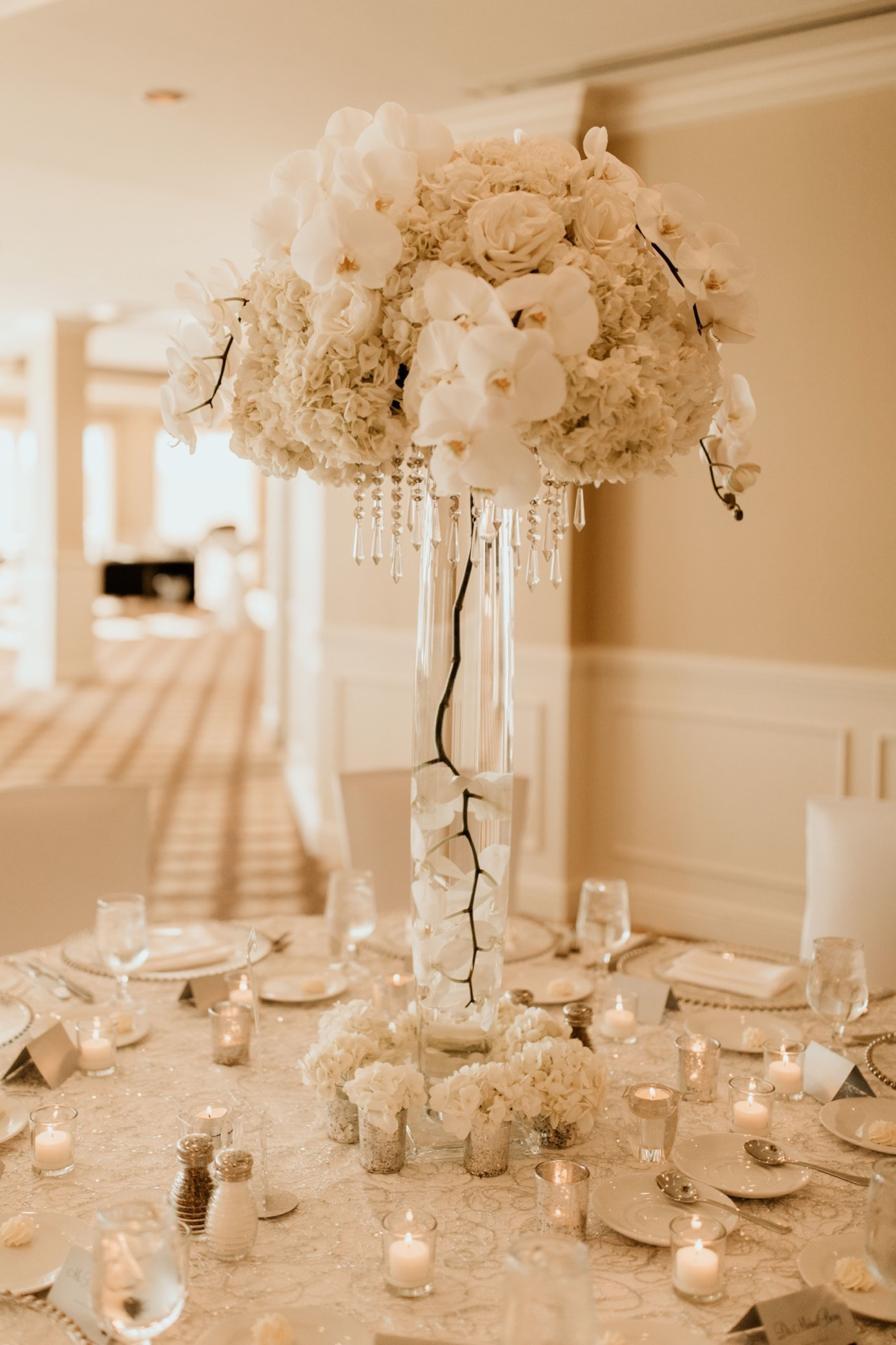 artisan orchid floral centerpieces at glen oaks wedding in des moines
