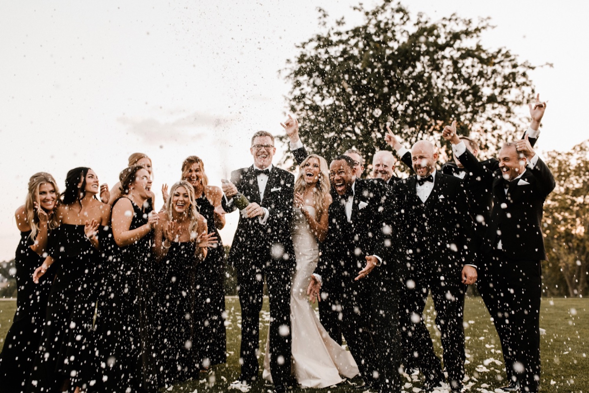 just married with a champagne bridal party toast and candid photo at glen oaks wedding