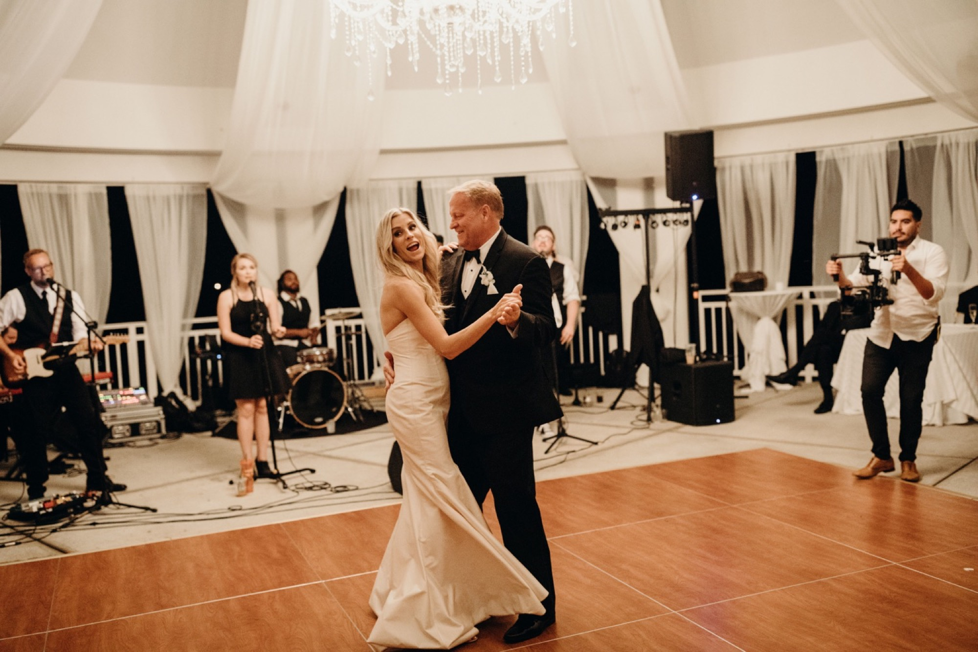 bride and father first dance during glen oaks wedding des moines
