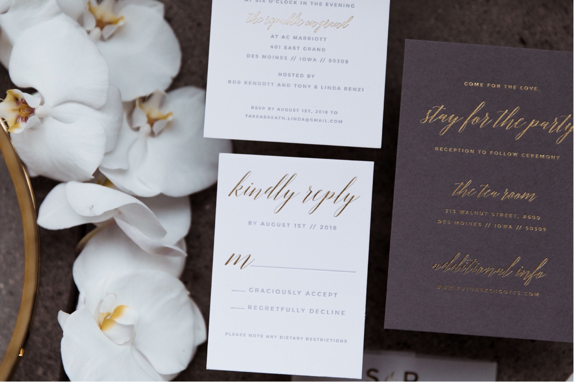 Flat lay invite suite with orchids for Des Moines wedding