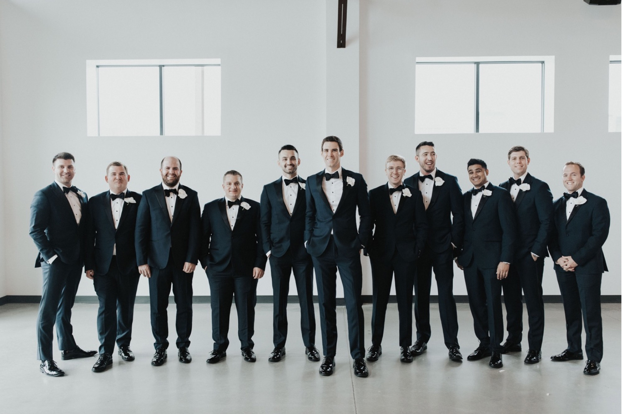 groom and groomsmen with orchid boutonnieres at curate wedding in Des Moines