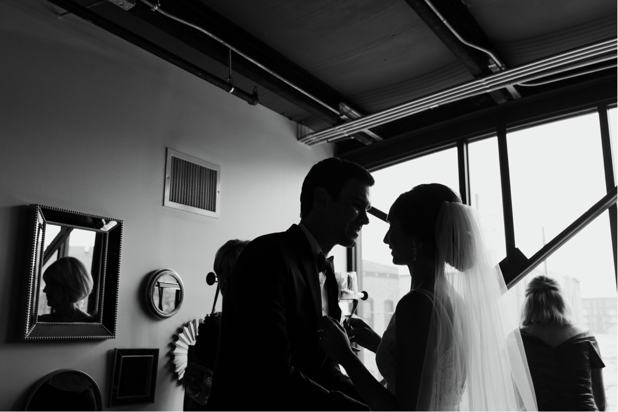 bride and groom embrace during intimate moment just before curate Des Moines wedding