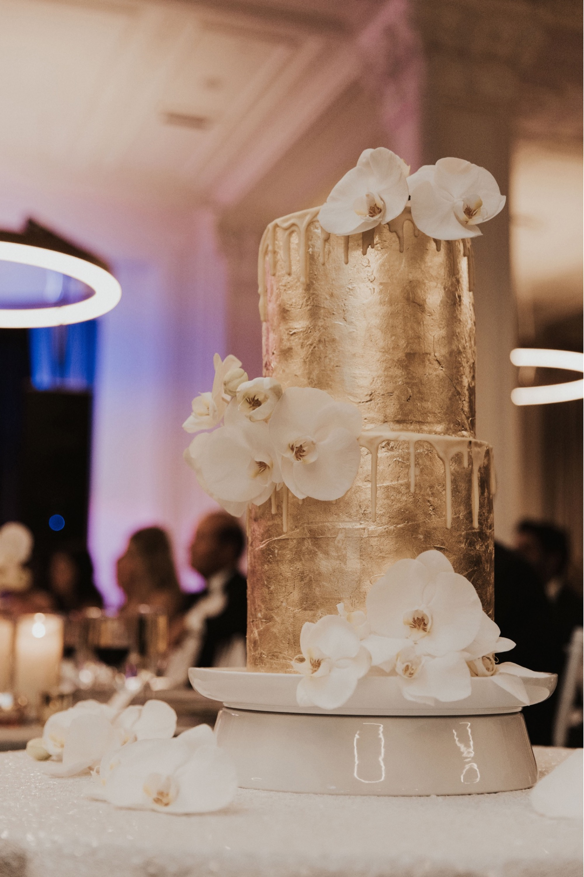 gold cake by dj three layer cake for brown trucking wedding at tea room in Des Moines