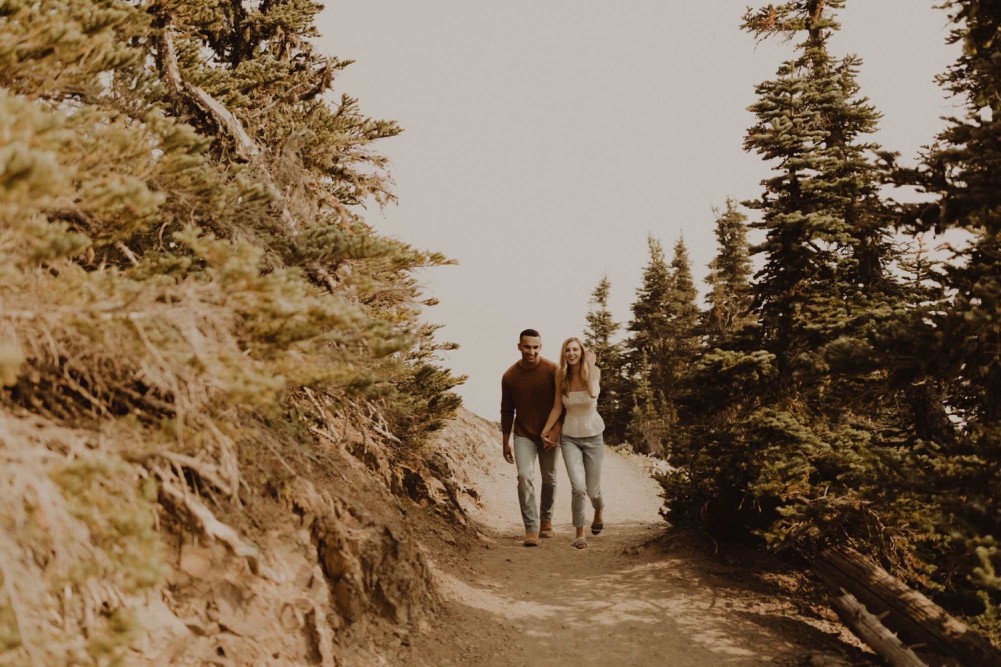 couple walking through hurricane ridge for engagement shoot