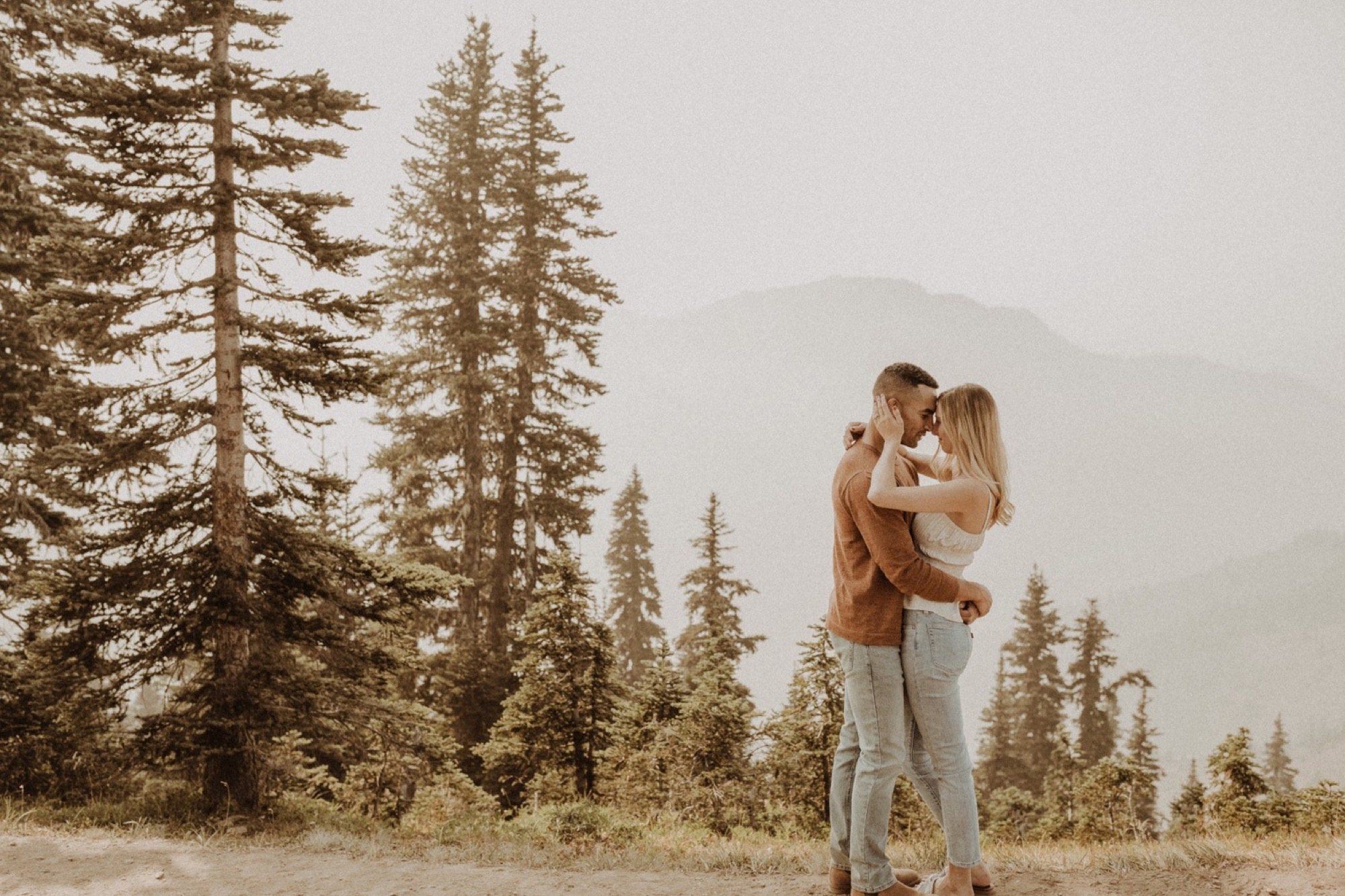 bride and groom embracing on hurricane ridge during olympic national park engagement