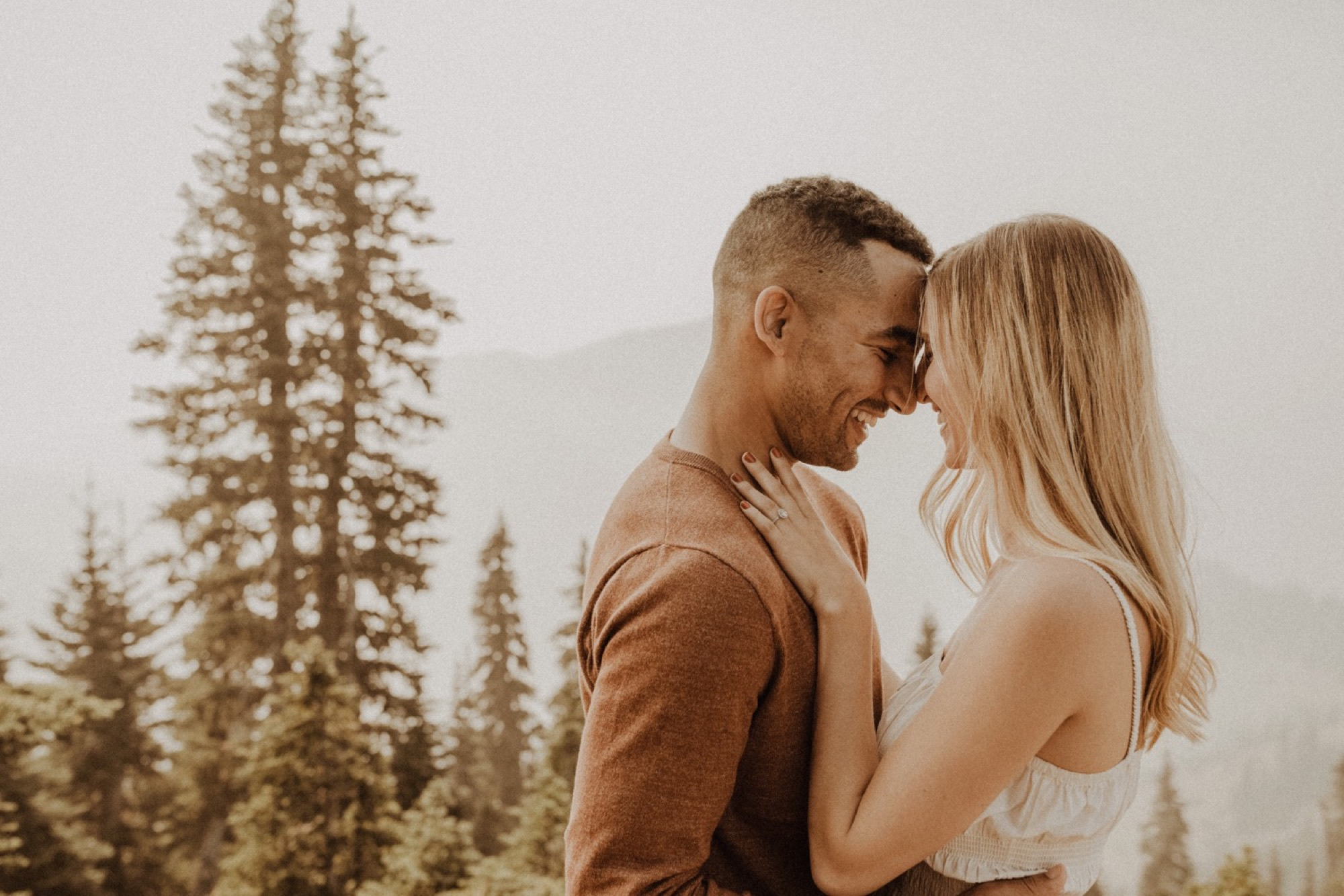 bride and groom laughing and kissing on hurricane ridge during olympic national park engagement