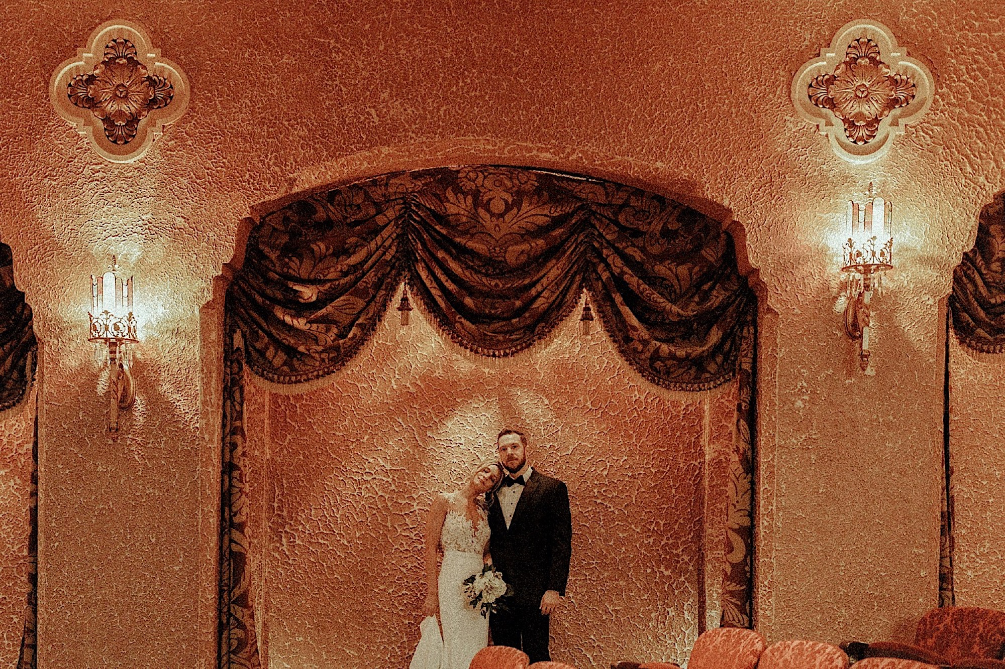 bride and groom in historic paramount theatre wedding