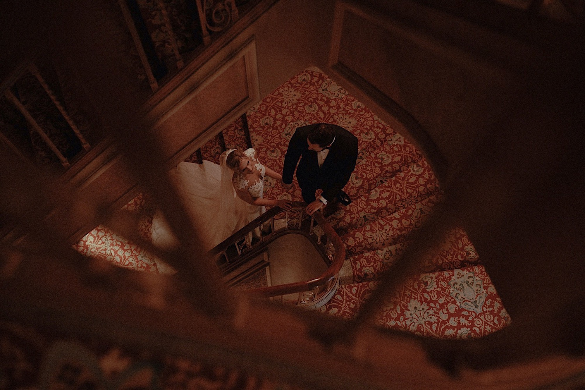 bride and groom embracing on stairs at historic paramount theatre