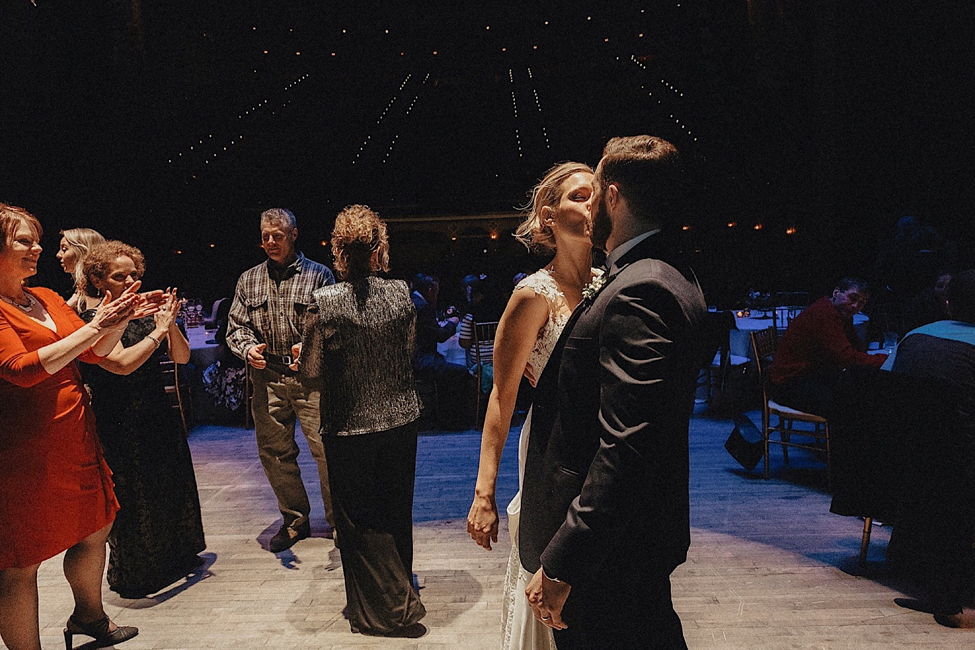 bride and groom during first dance on stage at historic paramount theatre wedding