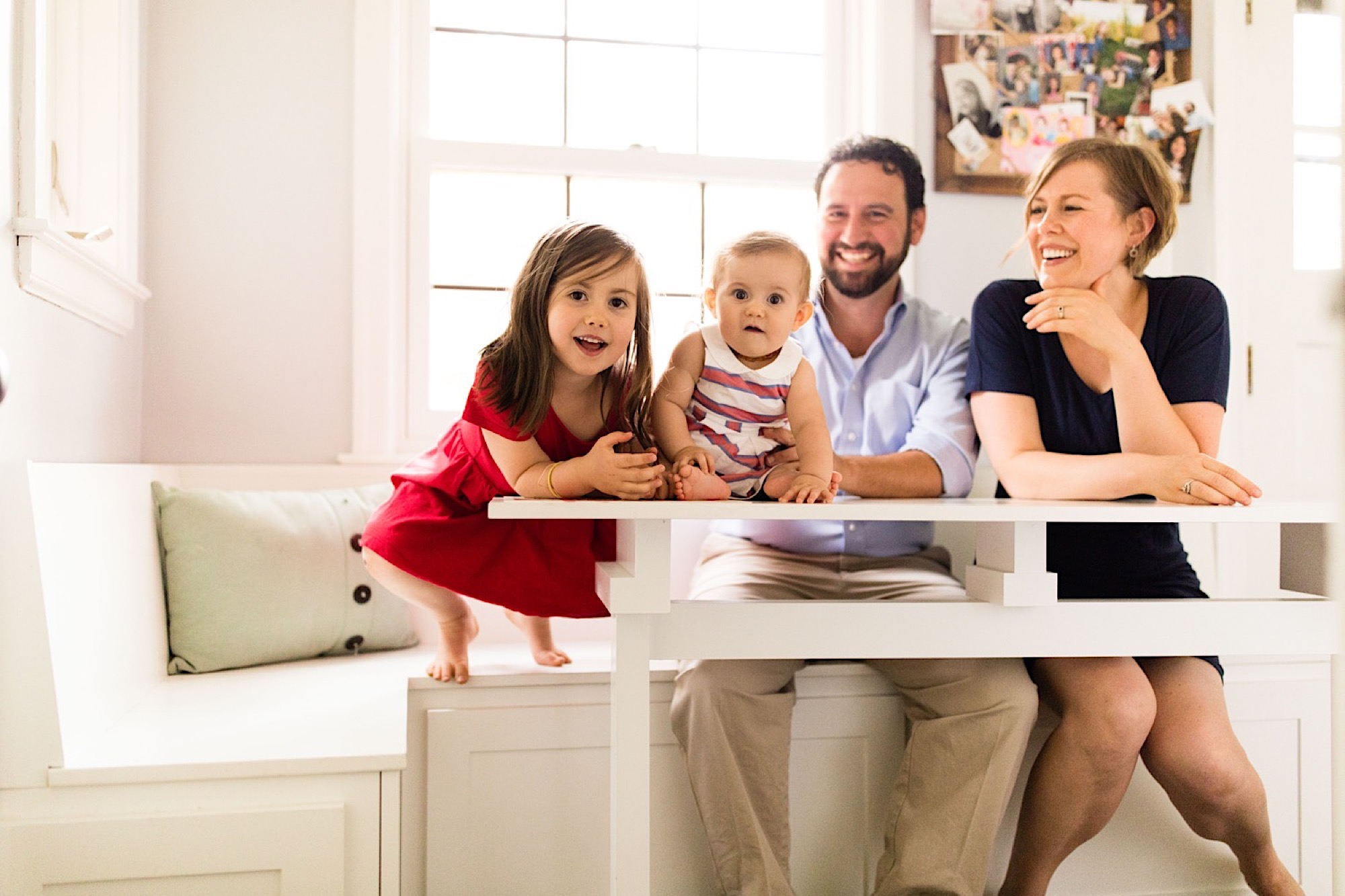 family smiling at breakfast nook