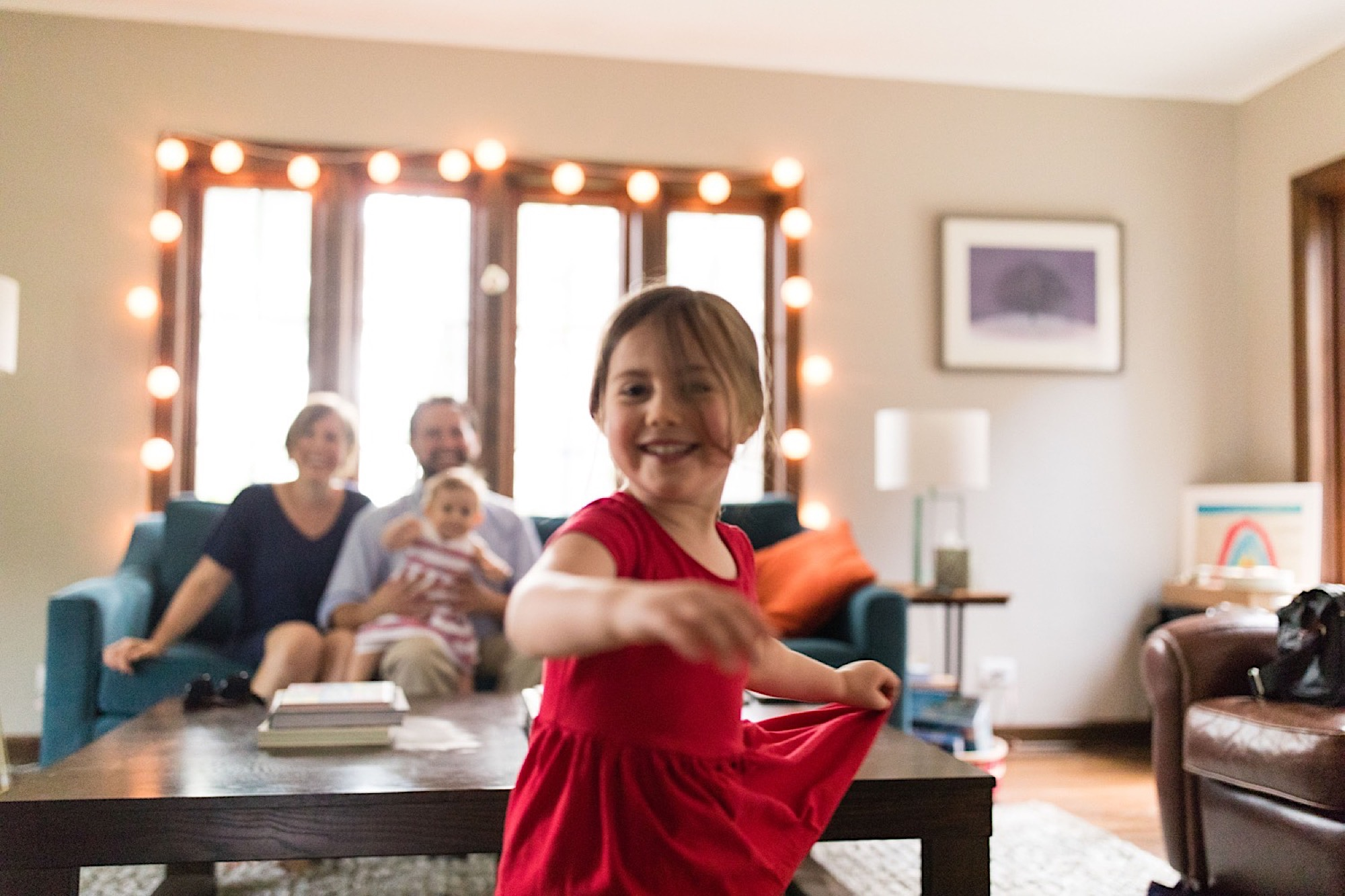 little girl dancing for family during family photo shoot