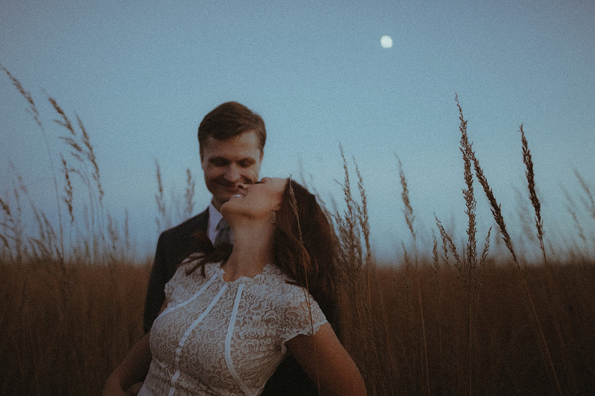 bride and groom during moonrise engagement shoot