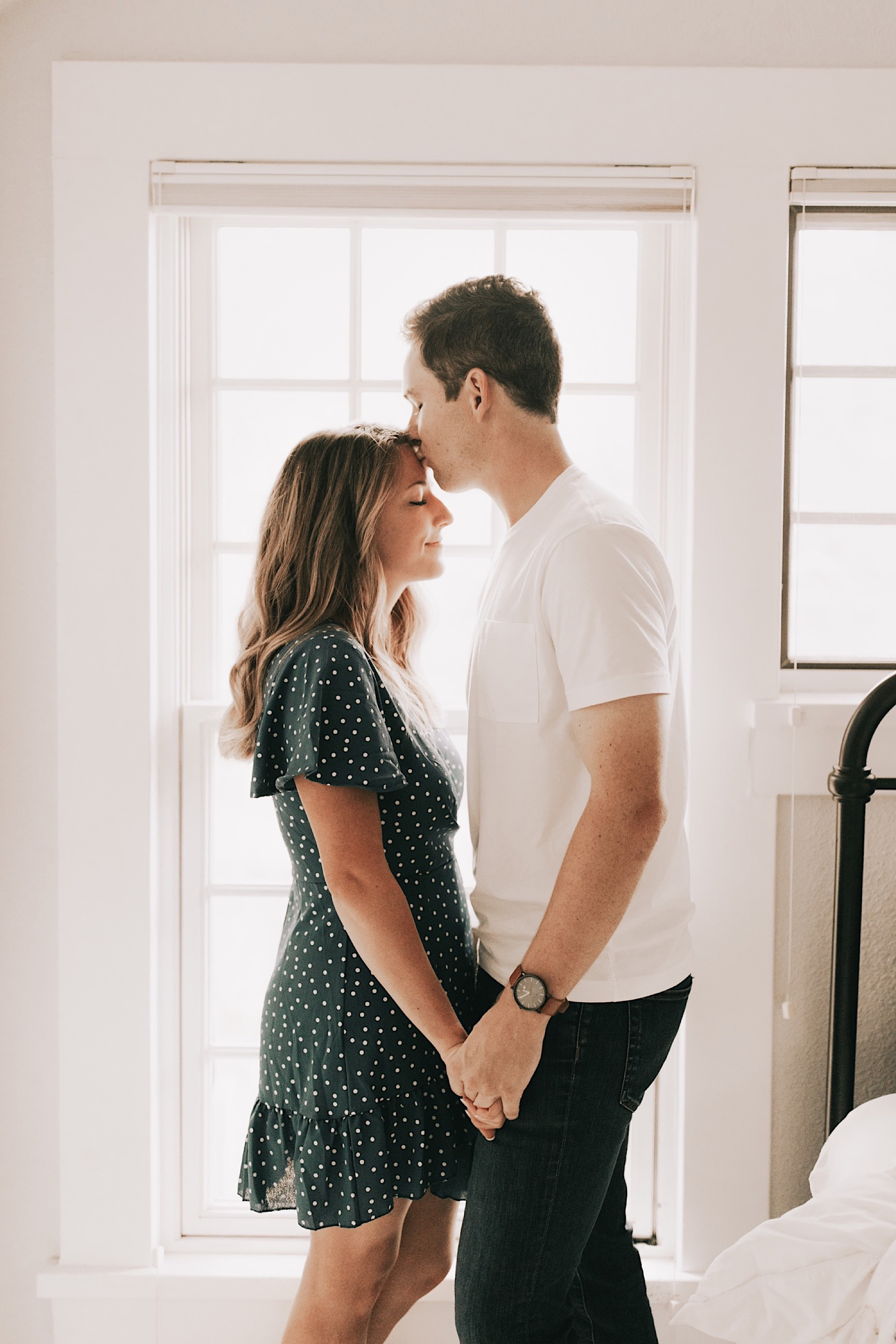 intimate moment during at home engagement shoot